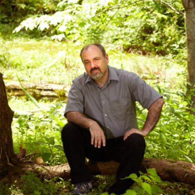 david winston sitting on log